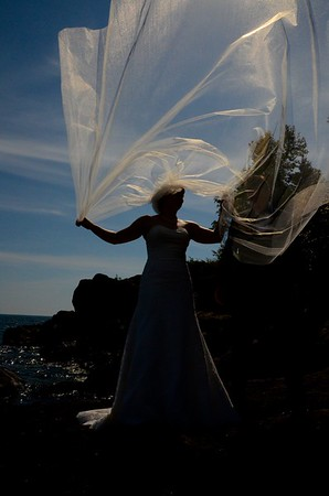 Day 346 -Jessica Lewellen was extremely patient while walking on jagged rocks and wearing a wind sail on her head.  What a beautiful day and happy to see some friends tie the knot and especially honored to take their photos.  This one just cracked me up. -AUGUST 19