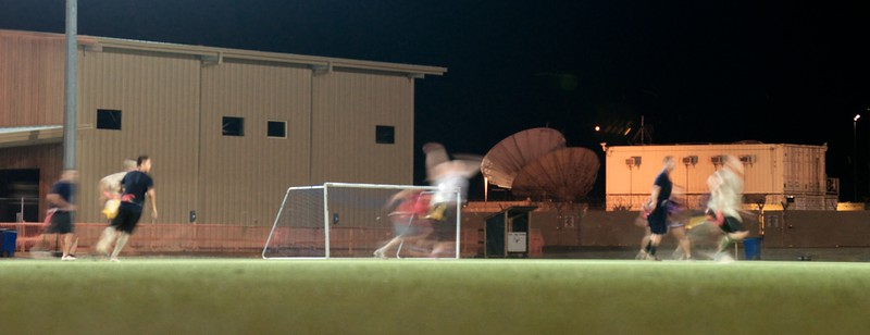 """Day 244 -Some service members having a late night of football on what's appropriately known as """"the turf field.""""  The other day I was looking at a friend's photos and she was doing took some night photos showing motion.  So she inspired me for today's photo.  Thanks Teresa, love the photos. -MAY 7"""