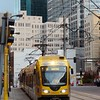 Day 043 -Had to run an errand in Minneapolis after work and snapped a photo of the light rail cruising by.  For some of the fans that have known me a long time, you may recognize my old work place in the background.  -OCTOBER 18