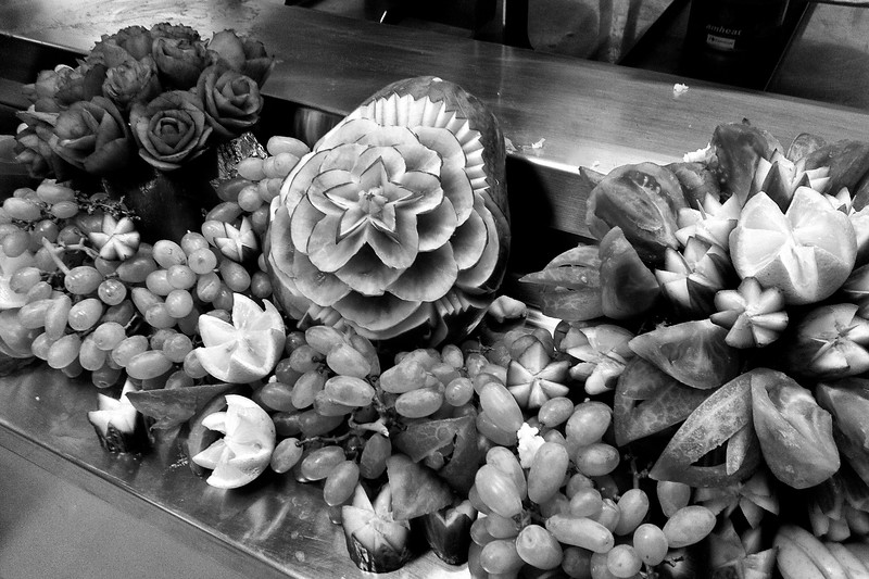Day 190 -This one might loose a little in black and white, but don't know I'll see fancy fruit carvings like this again.  No special occasion or anything, just a Thursday night at the galley. -MARCH 14