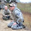 Day 092 -Staff Sgt. Spotts gives instruction on how to tactically move around.  This was shortly after having us low crawl through a muddy field.  However, if you notice his hat, we got a thorough demonstration first.  Luckily I had the best instructor.  -DECEMBER 6