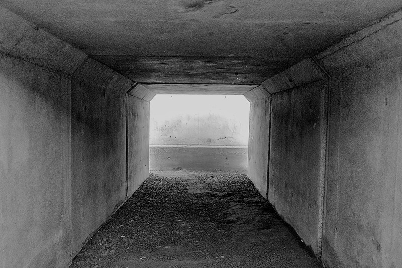 Day 168 -Stopped to grab a view of the bunker outside my my room.  Thankfully we haven't had to use them, but a cement tunnel always looks good and black and white. -FEBRUARY 20