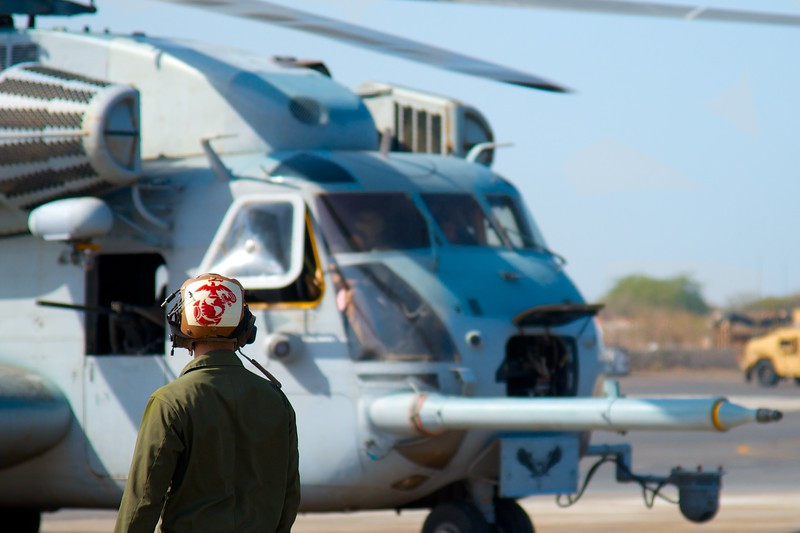 Day 133 -A Marine is watching and checking everything before one of his helicopters takes to the air.  They're pretty impressive machines. -JANUARY 15