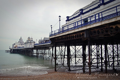 "Eastbourne  Taken on a rather grim day.  This pier was opened in 1870.  One of few proper 'pleasure' piers left in Britain really.  This is how a pier should be - lots of rides, tea rooms, tat shops.  Bit grubby even.  Wish Southend was a bit more like this.  Eastbourne Pier has the famous 'Camera Obscura' which I would love to have a peek at - but every time I go to Eastbourne, it's never open.  The Obscura is the dome on the first pavilion there and can be accessed via a set of stairs.  *Smugbugs haven't been fixed.  Hoping that my pic won't take eight hours to show up today, and that other people's pics show up today.  Otherwise we will be E for 'empty'.  I've already got some ideas for next Sunday 'F' and in a few weeks time 'J' - ""fooking"" and ""joke"" if this keeps up.*"