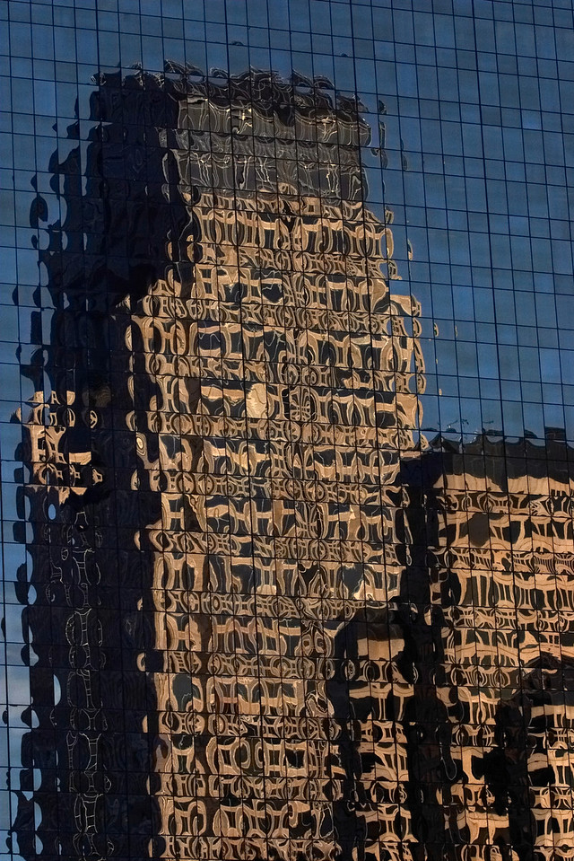 Reflection of Chase Tower off the Maxus Tower