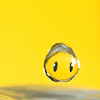 A water droplet smiles while on its way into the water below.