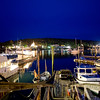 Enjoying the Calm of Boothbay Harbor<br /> I don't know. With all the crazy weather and so many folks struggling to get back to normal in the Northeast, I just had to go through my arsenal of photos and find a more peaceful time when I was there. One early summer evening in Maine, when I was sitting on the harbor in Boothbay, enjoying the stillness of the unseasonably cool night, I took this photo. It's nothing special. I just remember the peace I found just sitting there alone. I was actually freezing, while people back home in Phoenix, were unseasonable hot, smelting in the desert. A few days later in Maine it became unseasonably hot in the 90′s. We decided to cut our trip short because it became too hot in Maine. A 105 degrees in Phoenix feels better than 90 degrees in Maine. Go figure!<br /> <br /> Most of us just want things to be normal. I wish for folks that our struggling with the cold and their losses, will soon find their normal again. Things always come back around. I guess that's hard to believe when you're sitting in the midst of a crisis. But it will happen.. in time!