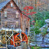 """Glade Creek Grist Mill""- is located in Babcock State Park in West Virgina. I had seen photos of this location for years and always wanted to go there and take a shot at it. As always timing is everything. I had check when fall foliage was at it's peak and planned my trip. Just before leaving on any trip, I check the weather forecast. A big front was moving through with lots of rain and wind. I postponed my trip to go after the storm had passed. Got there and 40 mile an hour winds had blown 80% of the colorful autumn leaves off the trees. Who would have known. Got up early and did the best I could and I'll be sharing those photos."