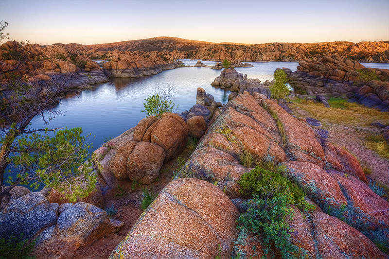 """Sunset Boulders at """"The Dells"""", Prescott, Arizona<br /> """"The Dells"""" at Watson Lake in Prescott are quite unique rock formations. As sunset approaches, the granite boulders light up with soft glows of orange, yellow and red. I'd like to catch these formations sometime with billowing  gray clouds in the distance for the HDR effect.  It's always been perfectly blue skies when I have been there."""