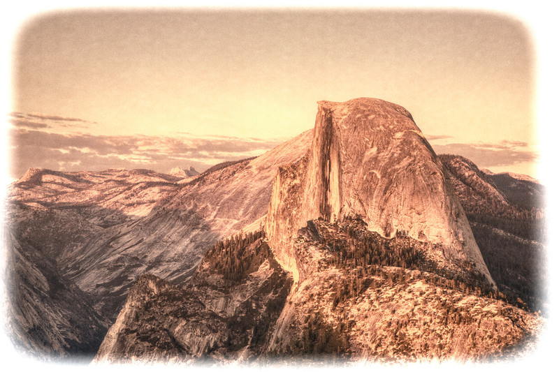 "Half Moon Sunset, Yosemite National Park<br /> Glacier Point in Yosemite National Park, is a great spot for photographing the high sierras with the big half rock or known as ""Half Moon"" in the foreground. I decided to give the photograph an aged flair, of what it might look like after sitting in a lost box of photos taken back in the 30 or 40′s. I occasionally get request to fix old photos of the past with the red pigment showing all that's remaining."