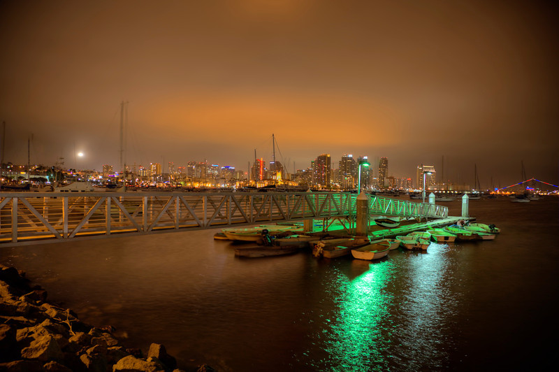 San Diego Skyline-The fog was starting to move in on San Diego one evening as we were strolling along the bay. The clouds and fog gave off bright hues of golds, yellows and browns. Other photographers were out trying to catch the skyline and complained their shots weren't coming out very well. I told them to try shooting multiple shots at different exposures and merge them later in a program like Photomatix. I don't know if they bothered, but I'm sure glad I did. The bay was rocking the mast of the sailboats pretty good and that was a pain to deal with the ghosting. Anti-ghosting settings in Photomatix helped, but as we know, movement doesn't heed well with HDR.