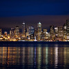 Seattle Reflections From Skyline<br /> After an evening chasing through downtown Seattle, enjoying the perfect weather at an outdoor restaurant, we found our way over to Skyline in West Seattle, which is the perfect spot for capturing the city lights of Seattle. It was our last night there before catching a cruiseship to Alaska for the week.