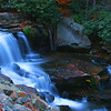 Wolf River Cascades in Autumn, West Virginia<br /> This was an interesting and fun photo to take. I was traveling on a dirt road, trying to find my way out from under the Royal Gorge in West Virgina where a had spent most of the day. It was pretty much dark and I decided to pulled over because I  heard the sound of rapids, an indication water was flowing over some rocks somewhere. Over the edge of a cliff I could barely see the rapids, so I thought what the heck, last photo of the day, I'll do an extremely long exposure and see what happens. The night was very still, which was a plus. The details in the shadows came out better than I expected, so I left satisfied that even in darkness, there still is a little light shining through.