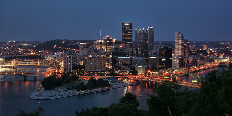 Pittsburgh Skyline from Mt Washington-I'm from Pittsburgh, Pa and was back visiting family for July 4th. I use to work in downtown Pittsburgh at the young age of 18, as a clothes salesman at Horne's. I don't even know if they're still around.  I missed the flight back to Phoenix, so I decided to spend the evening on top of a hill overlooking Pittsburgh at sunset.  As a kid living there I had no interest in photographing Pittsburgh. It wasn't until later years and traveling alot did I notice that Pittsburgh has one of the most beautiful skylines of any city, especially from the vantage point high on a hill overlooking it all.<br /> <br /> Knowing the Pirates were playing at the ballpark below (center left) made the evening even more special. The lights were so bright I had to crop it out because it dominated the photo. This photo was taken with 3 images merged in Photomatix.