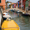 "Yellow Boat in Burano, Italy<br /> I was taking my chances of ending up in the ""drink"" in Burano with this photo. You can see by the photo, that I leaned way to far over the water, to get the boat as much in the photo as I could. Any farther and I was in the canal. It's kind of crazy when I look back, expensive camera and all, would never survive the splash. No one ever said photographers weren't a little crazy. But, I got the shot!"