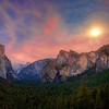 "Full Moon over Yosemite Valley<br /> Just got back from a 3 day trip to Yosemite National Park, California.  Been quite a while since my last visit, so it was time to return. I picked a great time to go with the full moon dominating the evening sky, but picked a bad time for catching the Yosemite Falls, which was dry at this time of year. I like shooting at twilight and/or the ""golden hour"". It was interesting my 1st day reaching this point at a vista above Yosemite Valley. The skies started out quite gray with a huge thunderhead over the Sierras, with no prospect of an exciting colorful sunset, as most of the 20 or so photographers, who were lined up, were murmuring. I knew the full moon was buried under those clouds somewhere and just maybe it would all break loose and shine through. The photographers seemed to be all on the same frequency, all packed it in and left except for me and another guy. Within 30 minutes the sky opened up and the moon shined through, along with remnants of red hues from a setting sun. Like a fishermen waiting patiently for a bite on his line, the fish took the bait and it was time to reel 'em in, and we reeled in some good shots..worthy of the wait. So a message to you photographers about the ""golden hour"", don't leave too soon..wait!!"