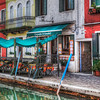 Tavernetta Ai Cesendeli-Burano, Italy<br /> One of my favorite places in Italy is near Venice. Burano a small island with a character uniquely it's own, is worth a visit when you're in Venice. A short boat ride brings you to this quaint colorful town with canals, restaurants, lace and gift shops. Every home and business is painted a different color of the rainbow. For a photographer, the camera never stops clicking. I've been here many times and always looking forward to the next possible visit.