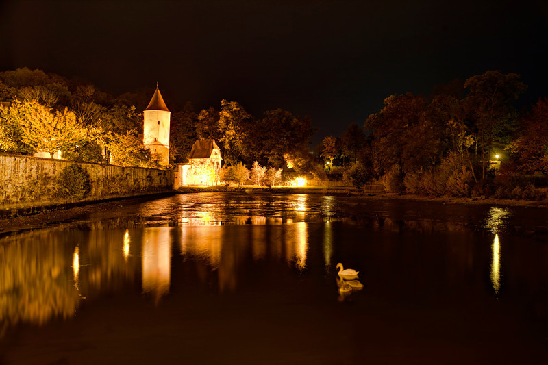 Gaulweither Pond in Dinkelsbuhl, Germany<br /> Just outside the gates to this walled city is a cool little pond that I heard is a great spot for night shots. Actually the whole city is a great place for night photography. The geese were restless, knowing I was on the banks of Gaulweither Pond that dark and lonely night last fall. I was hoping they would stay still, since I was taking long exposures. It took quite a few shots to find one where they weren't moving around.