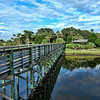 Walking Bridge to Nowhere, Florida-If anyone knows where this is let me know. We were going down the western coast of Florida, somewhere north of Clearwater, when this neat little walking bridge came up during a rest stop. Decided to check it out. It was a walkway that went out to a platform on the swampy inlet waters. I was sure there were alligator nearby waiting for us to accidently fall in. Made for an interesting HDR with the reflection off the water.