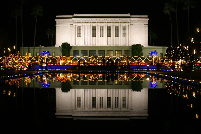 Christmas Lights in Reflection Pool, Mormon Temple, Mesa, Az<br /> The Mesa Mormon Temple lights up with hundreds of thousands of colorful lights to celebrate the birth of Christ. Folks come from miles around to enjoy this spectacle under clear and crisp December nights. This reflection is from a pool on the back side of the Temple looking south. Not an easy shot to get with 1000′s of people wandering around. To all have a safe and joyous Merry Christmas!!