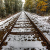 "Snowy Tracks along the Romantic Road in Germany<br /> Can anyone see the snow coming down? I get a kick out of photographing tracks. This one caught my attention because of the snow coming down and I'm always looking for ""leading lines"" in photography. The lines of the tracks lead you through the photo, down the tracks to where they look like their eventually touching. I put the tripod as low as it would go, and balanced the tracks in the middle. Look for ""leading lines"" in nature and you will probably find yourself creating a nice interesting photo to share."