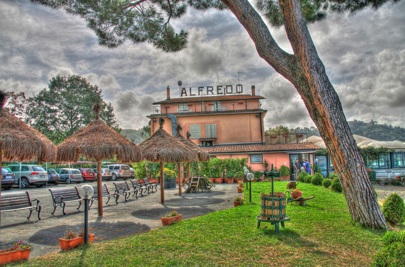 """Alfredo's at Bracciano Lake, Italy""-All I knew, when we arrived in Rome from our long trip from Phoenix is, I didn't want to drive far and I wanted a hotel on a lake for the night.  Italy doesn't have many lakes near Rome you can stay on. We planned a week traveling aimlessly through Tuscany on our destination in Cinque Terre.  We looked on the map and saw that north of Rome was just what our tired bodies had wanted, a lake. It was in the off season so we knew that getting a room would be easy. We found Hotel Alfredo on Bracciano Lake. A picture-perfect setting on a circular lake with Odescalchi Castle staring down on us. A full moon topped it off. What else could you ask for. Oh..It was my birthday!!"