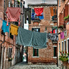 """Hanging Out To Dry, Venice""-In Venice, it's pretty common on the back streets to see folks hanging it all out to dry; work clothes,underwear, lingerie. On a pulley system, the rope rolls it in and rolls it out. I think at home if you let your under garments hang out to dry, for all to see, you might get arrested, or at least laughed at. Makes for an interesting shot. Lacking the space, all things modern haven't quite hit the back streets of Venice. Still one of my favorites places to go."