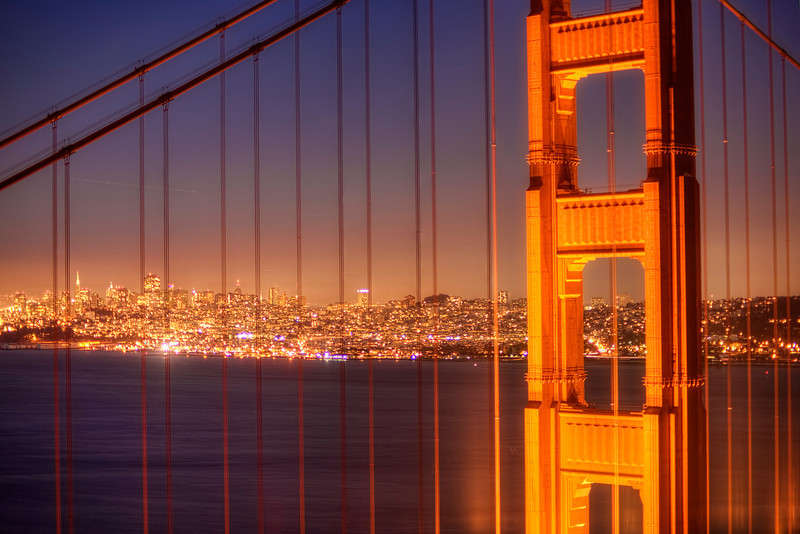 Twi-lights of San Francisco<br /> There's a great spot up on the hill above the Golden Gate Bridge at Hendrick Point,to photograph the city lights of San Francisco, looking east. There was a photography class of maybe 30 photographers all lined up, trying to get the shot. Fortunately for us, it was a fogless night, a rare moment here during our stay. I couldn't imagine charging people money, only to have the bridge completely fogged in. I guess you just take your chances.