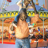 Day at the Carnival, Santa Barbara,Ca<br /> I thought this was a cool bronze-like statue of a boy enjoying a day with his father, uncle or someone special in his life, riding his shoulders, as they hung-out at the carnival. Kind of reminds me of the 50′s when I was a kid horsing around with my dad. This is located just off state street in downtown Santa Barbara, California.
