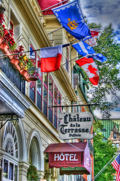 """Chateau de la Terrasse, Quebec City""-For us folks in the U.S., old Quebec City is about as close to European as you can get without going to Europe. That was the motivation to go. Buildings like this one were everywhere and quite colorful and fun to photograph. We pretty much did a walking tour around the entire old city in one day. Sure gives cause to wonder why we carry heavy photo equipment. Too bad they don't allow donkeys, because I sure in the heck would have liked to have had one.. this day!"