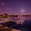 Moonlight Over The Dock, Gilbert, Arizona<br /> The last couple of nights after getting back from San Francisco, I was still in the photographing mood, so I wandered over to our park to capture some pretty awesome moon glows. The night before local fisher people took over the dock, but last night it was, quiet, calm and stellar. Spent a couple hours catching shots as the colors and hues kept changing. This one was one of my favorites.<br /> <br /> I had another camera going clickity-click every 10 seconds as the moon was rising. I plan on putting them together into a video form. Some time I'll show them!!