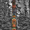 Totem Pole, Sitka, Alaska<br /> Many Totem Poles can be found as you hike the paths through Sitka National Historic Park in Alaska. Thought I'd turn the photo to black and white, and then colorize back in the original colors in Photoshop. It's interesting to see how many different variations the native indians came up with, for their unique totem pole. Sitka is one of my favorite Alaskan towns. It's easy to walk and enjoy this quaint part of Alaska. For some reason, each visit here has had the best weather, and maybe that's why I want to keep coming back.