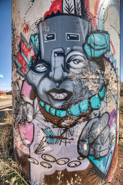 Indian Graffiti at Grey Mountain Trading Post, Arizona<br /> On route 89 to Page, Az, I happen to catch this colorful artwork on the side of the road, just before the Grey Mountain Trading Post. I just had to check it out. Someone decided to get creative on the side of some tanks, and I thought it looked kind of cool. What do you think? I looked at these tanks on Google Earth and their painted white. Makes you want to go..mm?