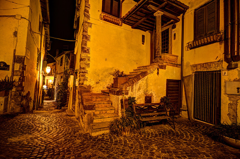 Cobblestone Streets of Trevignano Romano, Italy<br /> We flew into Rome early in the morning, in fact arrived on my birthday. I knew from past trips to Europe, the first day is a throw-away because, you have to get some sleep to function. I wanted to make it to Lake Bracciano north of Rome, and spend the day on a rare inland lake in Italy, on my birthday. First trick was getting there, without falling asleep at the wheel. We got there in the afternoon, found a hotel lakeside and crashed for a few hours. We found our way later that evening to Trevignano Romano for dinner, and then wandered the back cobblestone streets into the evening. As usual with our traveling style, we wing it and usually find some interesting places, off the beaten tourist routes.