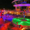 "Oo ee Baby, Won't You Let Me Take You On A Sea Cruise<br /> If you haven't tried cruising, you'll need to put it on your bucket list. For any age it is a whole lot of fun. You unpack once and you're good to go for the week. Royal Caribbean a few years ago added the ""Liberty of the Seas"" to their fleet of mega-ships. I personally like the mega-ships with big mall-like palisades, Ice skating rinks, rock climbing walls, and on and on. This is a shot of the colorful pool deck with the disco up above in the skybox. Like the old nostalgic song says..""Oo ee Baby, won't you let me take you on sea cruise""."