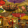 Umbrellas On Parade, San Francisco,Ca<br /> We were at The Fish Market in Seattle when we went by a store that was all umbrellas, and quite fancy ones at that. I had never seen a store that specialised in elaborate colorful umbrellas before. I wonder if people actually go out in the rain with those expensive things. Being from Phoenix, we hardly ever see umbrellas. If we're going to a rainy location, we usually pack the kind you can fold up and put in a suitcase. If it breaks we just throw it away. I guess if you break one of those expensive ones, you can use the material for scarfs or handkerchiefs, or something.