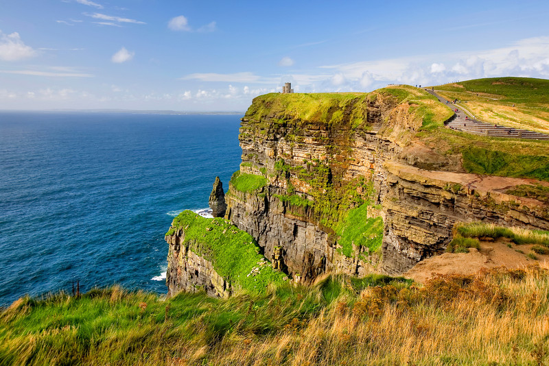 """Obrien's Tower at Cliffs of Moher, Ireland""-There was a time when they would allow you out on the edge of the cliffs, where you could lie down and look staight over the edge to the jagged rocks below, until people started falling off! Now you keep a safe distance and feel the awesomeness of this Irish landmark. Looking west you know somewhere out there is the good old U.S.A. and that's comforting. This is Ireland most visited attraction and for good reason. It's magical."