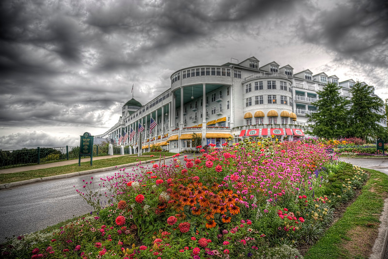 """HDR-Grand Hotel, Mackinac Island, Michigan<br /> This classic hotel was built in 1887 on Mackinac Island, just east of Mackinaw City on Lake Huron, Michigan. Everyone who visits wants to relive the famous 1980 movie, """"Somewhere in Time"""", starring Christopher Reeves and Jane Seymour. With sprawling Verandas and scenic overlooks across Lake Huron, fountains and gardens, a little romance of yesteryear is in the air. Some dramatic clouds rolled in making an HDR photo so much the better."""
