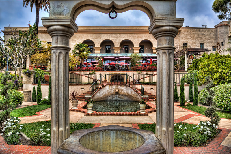 """Buy This Photo""- The Wishing Well, Balboa Park, San Diego-As most HDR photographers know, cloud formations add alot of character to HDR shots and a whole lot of fun in the post-processing.  San Diego this week was cloudy or should I correctly say, the ""marine layer"" was hovering over the city for most of the days we were there. This is great for photography, not so great if you want to lay on the beach. We spent time in Balboa Park around the museums. The Spanish Baroque architecture is elaborate and a thrill to photograph. It definitely takes you back to another era."