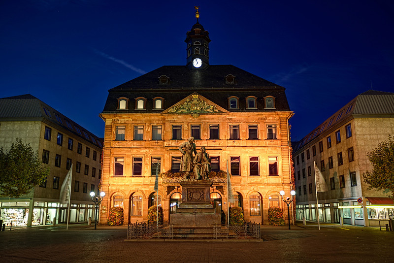 """Statue of James & Wilbur Grimm, Hanua, Germany<br /> We flew into Frankfurt busted tired. A  flight all the way from Phoenix, Az can do things to you. It was 8:00 a.m. and I told my wife we should find a place to acclimate and get some rest. I said; just find a town on the outskirts of Frankfurt and we'll hit the """"Romantic Road"""" to start our journey south from there. We ended up in Hanua. Later in the day, we ventured out from our hotel room and found this piazza. We took pictures standing next to the statue not realizing it was the """"Brothers Grimm"""".They are among the most well-known storytellers of European folk tales. Some of the most famous ones are: Cinderella, Hansel and Gretel, the Frog Prince, Rapunzel and Snow White."""
