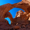 """Double Arch, Utah""-Traveling in Pittsburgh at the time for July 4th week. Got back from Pismo Beach a couple of days ago and will have some nice photos to share from that trip.<br /> <br /> Arches National Park in Utah on a very windy, but sunny day. Double Arch is a short hike up to this massive arch. It's hard to get a true picture of the shear size of this thing. I'm using a wide angle 16-35 mm Canon lens to capture it and I'm literally right up underneath of it  shooting  almost straight up. Great experience."