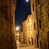"""Moonstruck in Siena""-The dark corridors of ancient Italian villages and towns make for some interesting eerie HDR's. We happen to be in Tuscany during a full moon, so it just had to be in the pictures. Cobblestone streets lead out to open piazza's where you will usually find people meandering, restaurants and pizzerias buzzing and shops galore promoting their wares. Searching out dark hidden pathways made it all the more fun and exciting to try out some high dynamic range photography. The older and grainier the better."