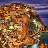 Manarola, Cinque Terre, Italy-The picturesque cliff-towns along the Ligurian Sea make up an area called Cinque Terre. Five towns along the Italian riviera welcome visitors to a unique world of discovery that dates back a 1000 years. More Americans are showing up here to spend a week hiking the trails that hug the coastline for some of the most beautiful scenery in the world. Breathtaking views at every turn and with the train going between each of the towns every 10 minutes, when you get tired of hiking, grab a train and you're back to your hotel in a flash.<br /> <br /> During the days in Cinque Terre, we would scope out vistas to photograph at sunset, and then return to grab the shot. Afterwords we would sit out at one of the local restaurants and enjoy a meal under the stars. The weather for us was perfect and the fall is a great time to visit. Crowds are less and rooms are much cheaper. You need a week to really do this place right. And my suggestion is stay in a little beach town close by called Levanto.