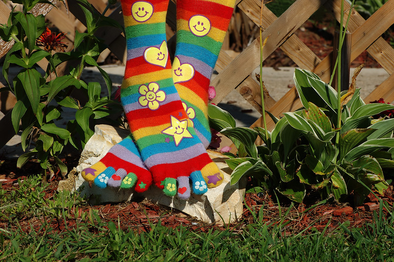 Smiley Socks ~ Happy FeetHere's a pair of socks I got yesterday in none other than Vandalia's Dollar General. $2 wasn't a bad price to pay for a smile and several good belly laughs when I got home :-)  Of course I had to wear them today. Can't hold the camera up due to my ruptured disks right now, but put it on the tripod and snapped away with the remote - lol. Rodney laughed even harder when I asked him to help me set it up and again when I was posing my toes. His belly hurts! LOL! PAD DATE: August 29th, 2009