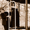 """<div align=""""center""""> <h2> Brennon & Shelby ~ Prom Playground Sepia</h2> This was a blast to shoot. We went to the woods, the Perry park, an old iron bridge and the city lake all before they headed to prom. This one in sepia has gotta be one of my faves from the entire day. I love their expressions. Recently we were talking about gearing up for Shelby's senior photo session and they informed me we'd be trashing the dress with purple paint... oh my... this is really gonna rock :-D   PAD DATE: September 8, 2009 </div>"""