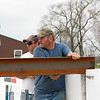 """""""Home Construction - Beam Placement 3""""<br /> PAD - August 31th, 2006 / Photo Captured April 6th, 2006<br /> Seems like it's been so much longer ago... time sure does fly when your building.<br /> BTW: That's my handsome hubby guiding the beam in place :-)"""