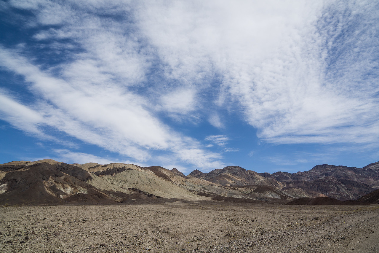 Blue sky looms over the mountain range bordering Death Valley