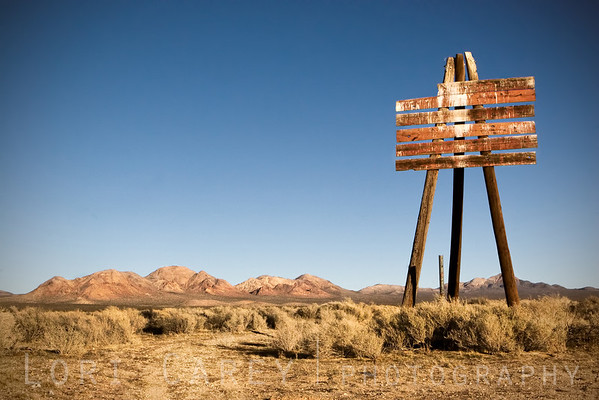 Blank signpost standing tall on three legs near the old gunnery range at Cuddeback Lake in the Mojave Desert, California.