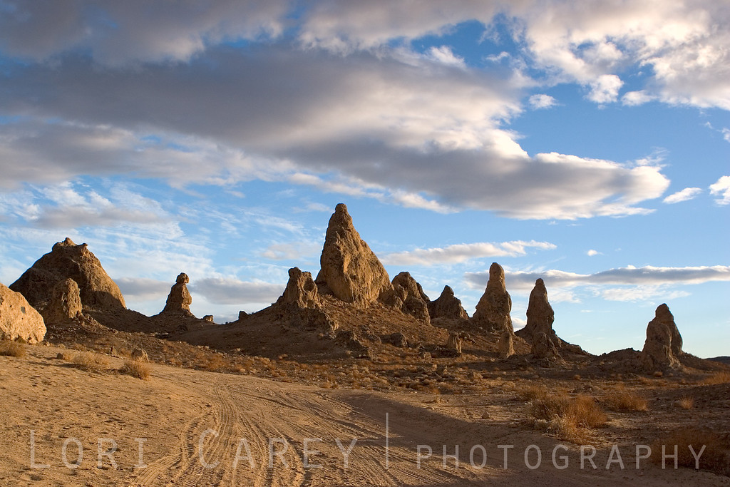 The surreal tufa spires of the Trona Pinnacles rise from the bed of Searles Dry Lake. They were formed underwater between 10,000 and 100,000 years ago when Searles Lake formed a link in an interconnected chain of Pleistocene lakes stretching from Mono Lake to Death Valley. The Trona Pinnacles are located 20 miles east of Ridgecrest, California in the Mojave Desert. <br><br>