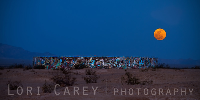 Supermoon of 5 May 2012 rising over the Kama Sutra Tank, aka the Sex Tank, in Slab City behind Salvation Mountain in Niland, California